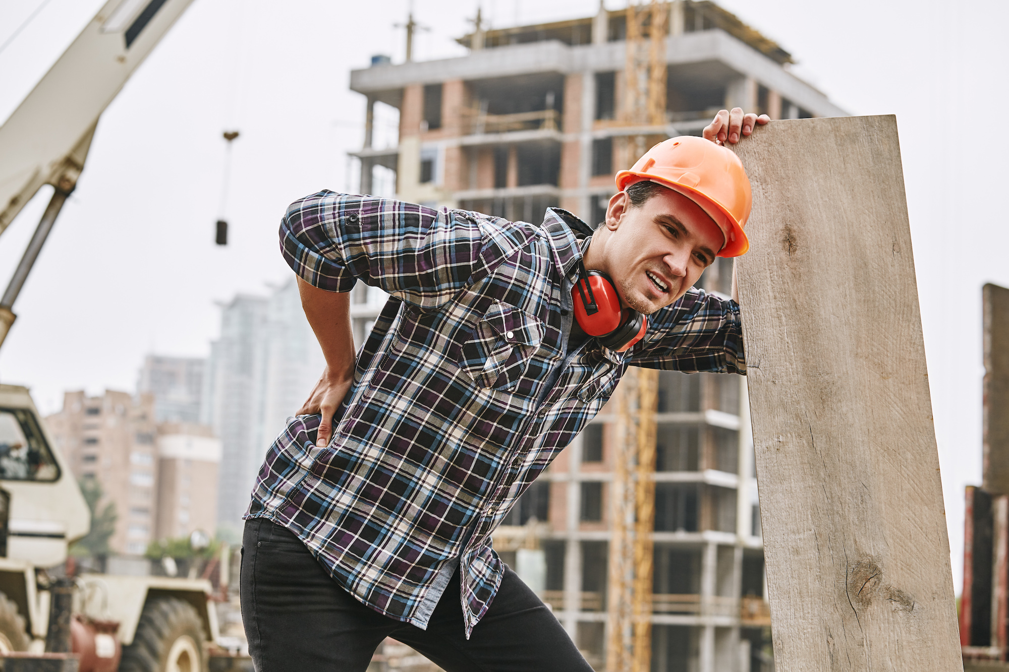 construction worker with back pain needs workers' compensation injury care